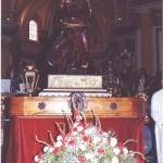 La canastilla para la ofrenda a la Virgen del Pilar ante el paso titular de la Cofradía
